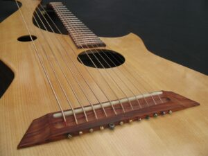 bridge of harp guitar