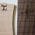 Laser Engraved logos and designs on harp guitars
