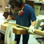 Anthony buffs a harp guitar