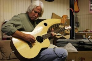Scott Wilburn trying out a Tonedevil S-12 Harp Guitar