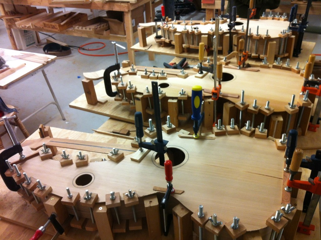 3 harp guitars with tops gluing on