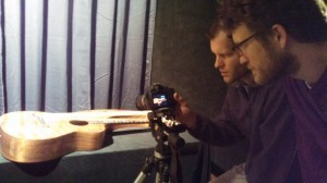 photographing harp guitar